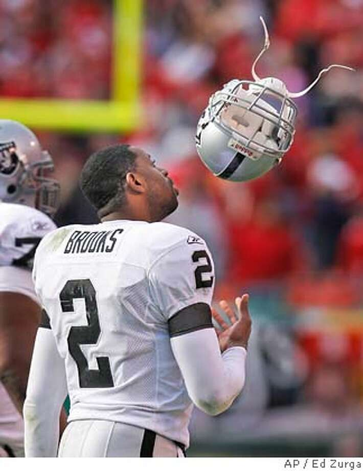 Oakland Raiders quarterback Aaron Brooks (2) tosses his helmet after throwing an interception during the closing minutes of their football game against the Kansas City Chiefs, Sunday, Nov. 19, 2006, in Kansas City, Mo. (AP Photo/Ed Zurga) Photo: ED ZURGA