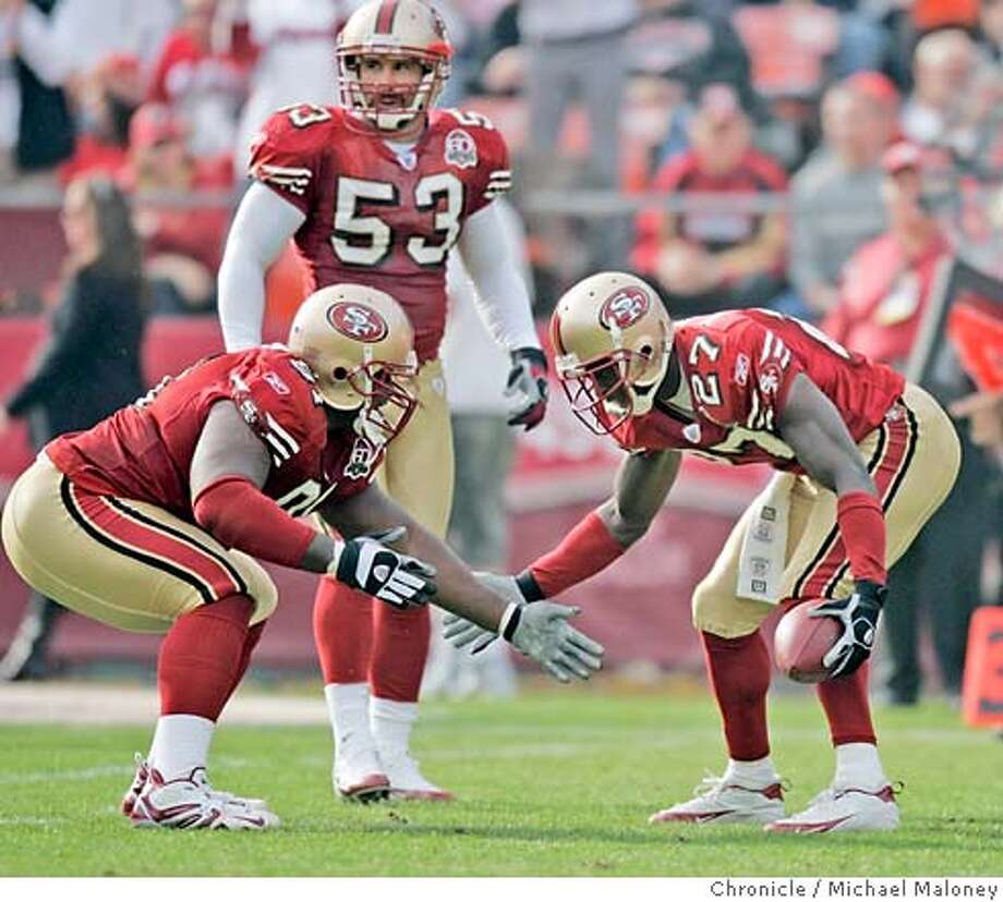 San Francisco 49ers Anthony Adams #91 and San Francisco 49ers Walt Harris #27 celebrate Harris' interception in the 2nd quarter. In center is San Francisco 49ers Jeff Ulbrich #53.  San Francisco 49ers vs Seattle Seahawks at Monster Park.  Photo by Michael Maloney / San Francisco Chronicle on 11/19/06 in San Francisco,CA *** MANDATORY CREDIT FOR PHOTOG AND SF CHRONICLE/ -MAGS OUT Photo: Michael Maloney