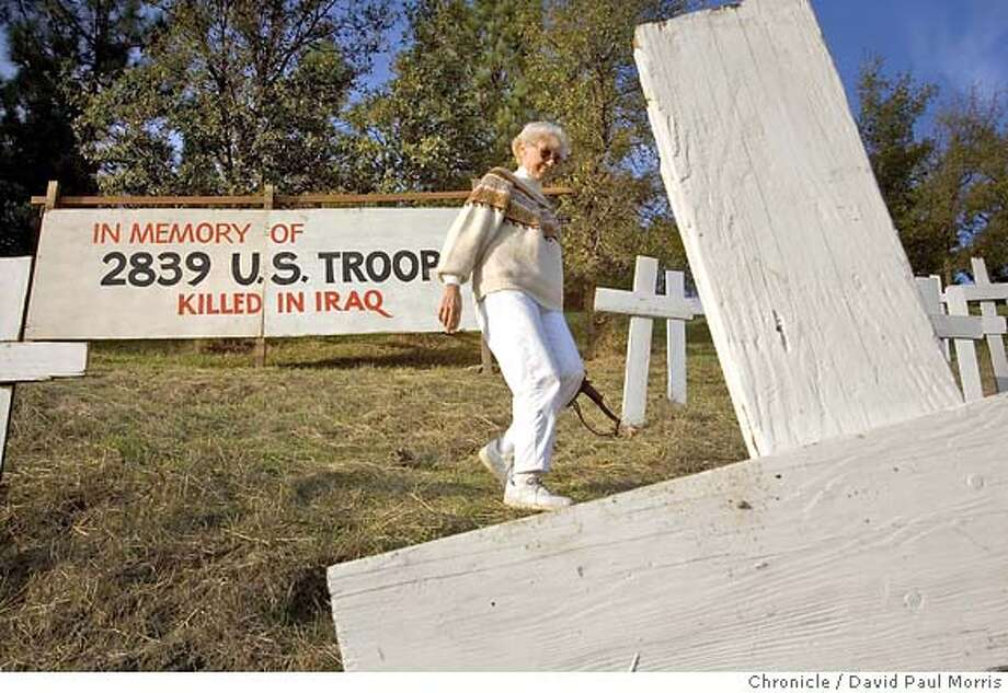 LAFAYETTE - NOVEMBER 17: Louise Clark walks past a sign on her property calling attention to number of US troops killed in Iraq on November 17, 2006 in Lafayette, California. (Photo by David Paul Morris/The Chronicle) Photo: David Paul Morris