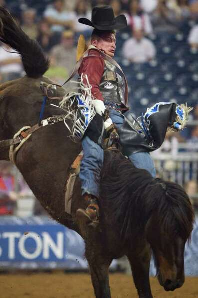Jake Vold rides Real Deal during bareback riding competition at the Houston Livestock Show and Rodeo