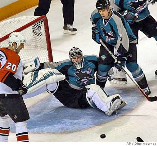 San Jose Sharks goalie Vesa Toskala of Finland blocks a shot by Philadelphia Flyers' Derian Hatcher, not seen, as San Jose's Rob Davison (5) helps out and Flyers' R.J. Umberger watches during the first period of an NHL hockey game Saturday, Nov. 18, 2006, in San Jose, Calif. (AP Photo/Dino Vournas) Photo: DINO VOURNAS