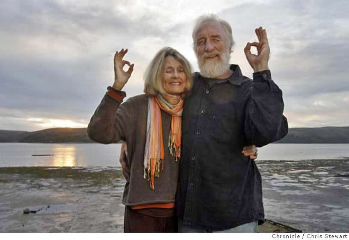GLOBAL_O_18_0051_cs.jpg Marin County anti-war activists and life partners Donna Sheehan and Paul Reffell (misspelled on photoassignment) flash the secret Global Orgasm hand-sign as they stand on the deck of their Marshall, California home, November 17, 2006. The pair are involved with Global Orgasm, a winter solstice event conceived to
