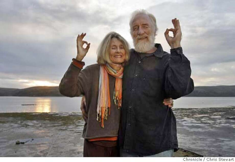 "GLOBAL_O_18_0051_cs.jpg  Marin County anti-war activists and life partners Donna Sheehan and Paul Reffell (misspelled on photoassignment) flash the secret Global Orgasm hand-sign as they stand on the deck of their Marshall, California home, November 17, 2006. The pair are involved with Global Orgasm, a winter solstice event conceived to ""effect change in the energy field of the Earth through input of the largest possible surge of human energy,"" that takes place on December 22.  Chris Stewart / The Chronicle MANDATORY CREDIT FOR PHOTOG AND SF CHRONICLE/ -MAGS OUT Photo: Chris Stewart"