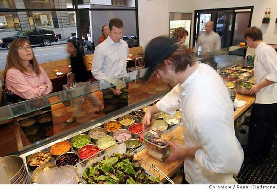 SPECIAL19  Just before the lunch rush, Matt Brown serves customers at the salad bar at Mixt Greens. This is an eco-friendly organic restaurant that's very popular with the Financial District crowd Event on 11/8/06 in San Francisco.  Penni Gladstone / The Chronicle MANDATORY CREDIT FOR PHOTOG AND SF CHRONICLE/ -MAGS OUT Photo: Penni Gladstone