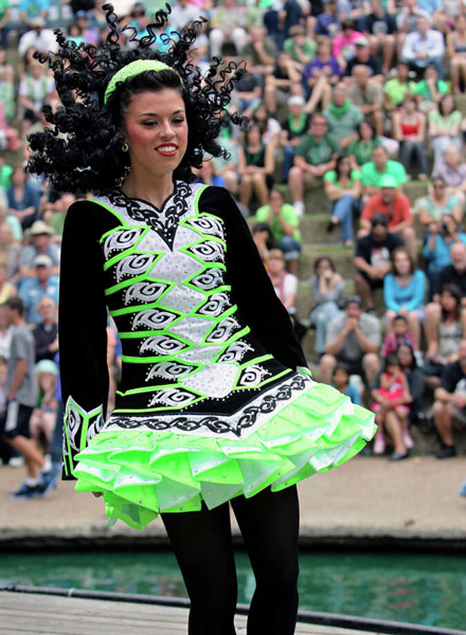 Inishfree Irish Dancer member, Ashleigh Hopkins, whirls around in a solo performance during the St. Patrick's Day festivities at Arneson River Theatre on  March 16, 2012. Photo: TOM REEL, Tom Reel / Treel@express-news.net / San Antonio Express-News