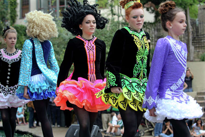 Colorful costumes fill the stage as the Inishfree Irish Dancers take the stage during St. Patrick's Day festivities at Arneson River Theatre on March 16, 2012.