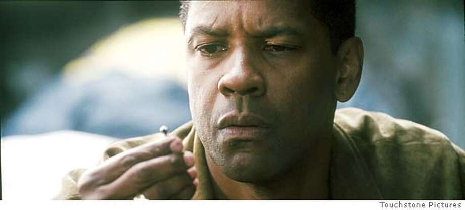 DENZEL WASHINGTON � TOUCHSTONE PICTURES AND JERRY BRUCKHEIMER, INC., ALL RIGHTS RESERVED Photo: ROBERT ZUCKERMAN