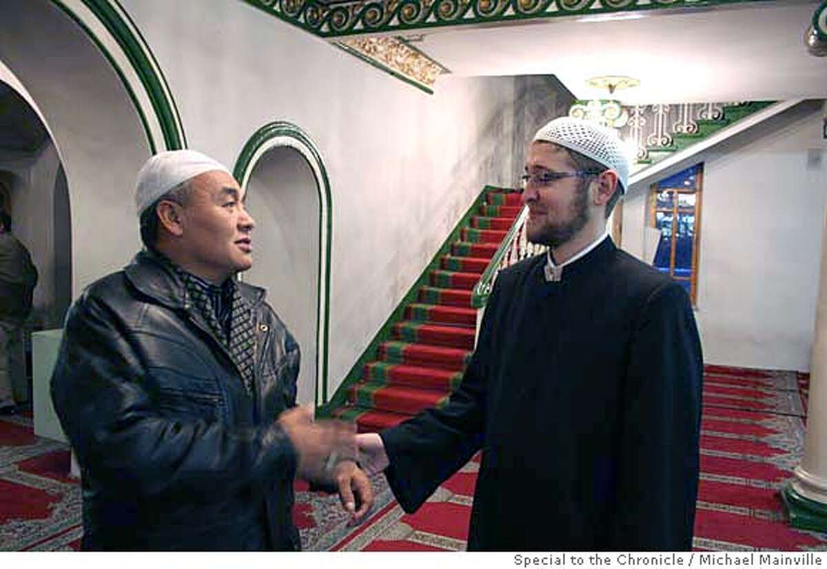 Ildar Alyautdinov, right, an imam at the Sobornaya Mosque, chats with a worshipper following afternoon prayers. Michael Mainville/Special to The Chronicle Ran on: 11-19-2006 Sobornaya Mosque, overshadowed by Moscows 1980 Olympics stadium, is one of four mosques for the capitals 2.5 million Muslims.