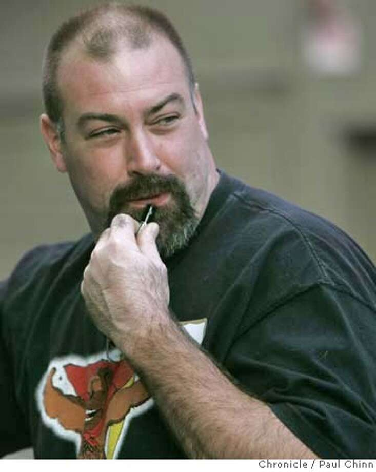 Jeff Meek simulates blowing a safety whistle that was distributed to volunteers attending the first meeting of the Castro Community On Patrol neighborhood safety patrol in San Francisco, Calif. on Saturday, Nov. 11, 2006. The roving patrols, scheduled to hit the streets on Nov. 17, were organized following two rapes and other violent crimes in the neighborhood in recent weeks.  PAUL CHINN/The Chronicle  **Jeff Meek MANDATORY CREDIT FOR PHOTOGRAPHER AND S.F. CHRONICLE/ - MAGS OUT Photo: PAUL CHINN
