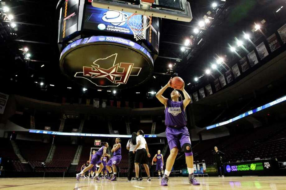 Albany's Ebone Henry shoots during basketball practice in College Station, Texas, Friday, March 16, 2012. Albany is scheduled to play Texas A&M in an NCAA tournament first-round women's college basketball game on Saturday. (AP Photo/David J. Phillip) Photo: David J. Phillip