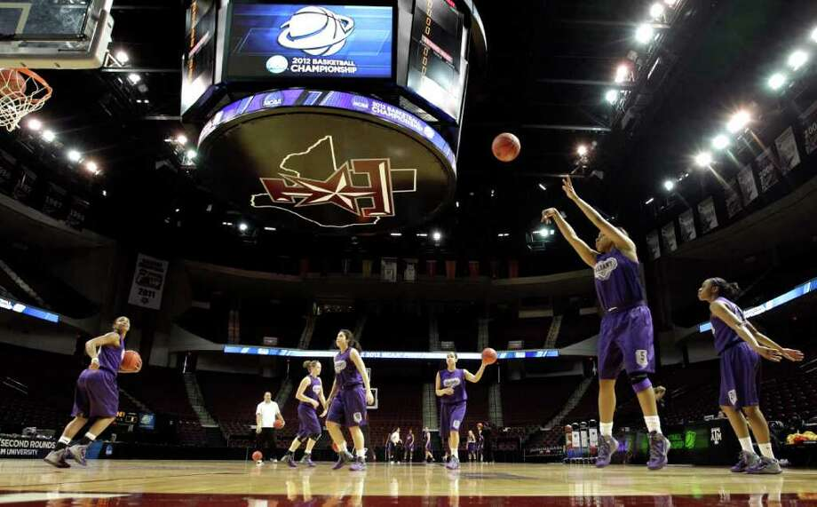 Albany's Ebone Henry (5) shoots during basketball practice in College Station, Texas, Friday, March 16, 2012. Albany plays Texas A&M in an NCAA tournament first-round women's college basketball game on Saturday. (AP Photo/David J. Phillip) Photo: David J. Phillip
