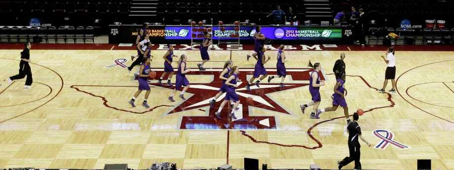 Albany players run across the court during basketball practice in College Station, Texas, Friday, March 16, 2012. Albany is scheduled to play Texas A&M in an NCAA tournament first-round women's college basketball game on Saturday. (AP Photo/David J. Phillip) Photo: David J. Phillip