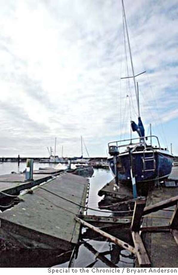 """Dale Hendrix's boat still lies atop what remains of """"F"""" dock. Crescent City, CA, November 16, 2006. Bryant Anderson/Special to the Chronicle Photo: Bryant Anderson"""