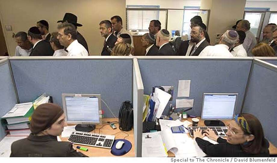 Modi�in Illit, Israel: 10-17-2006: Eli Yishai (7th from left in back), the head of the Shas Ultra-Orthodox Party in Israel walks by female employees at Citybook Services, a US based outsourcing firm which employs Ultra Orthodox women in their Israeli office. David Blumenfeld/Special to The Chronicle NO MAGS, , NO TV Photo: David Blumenfeld