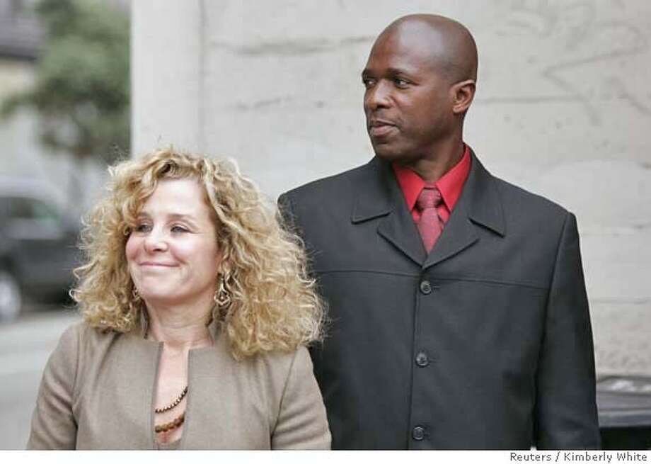 Trevor Graham (R), the track coach who triggered the BALCO doping scandal, leaves a federal courthouse with his attorney Gail Shifman in San Francisco, California, November 16, 2006. Graham pleaded not guilty to lying about his role in and his knowledge of steroid distribution.  REUTERS/Kimberly White (UNITED STATES) Photo: KIMBERLY WHITE