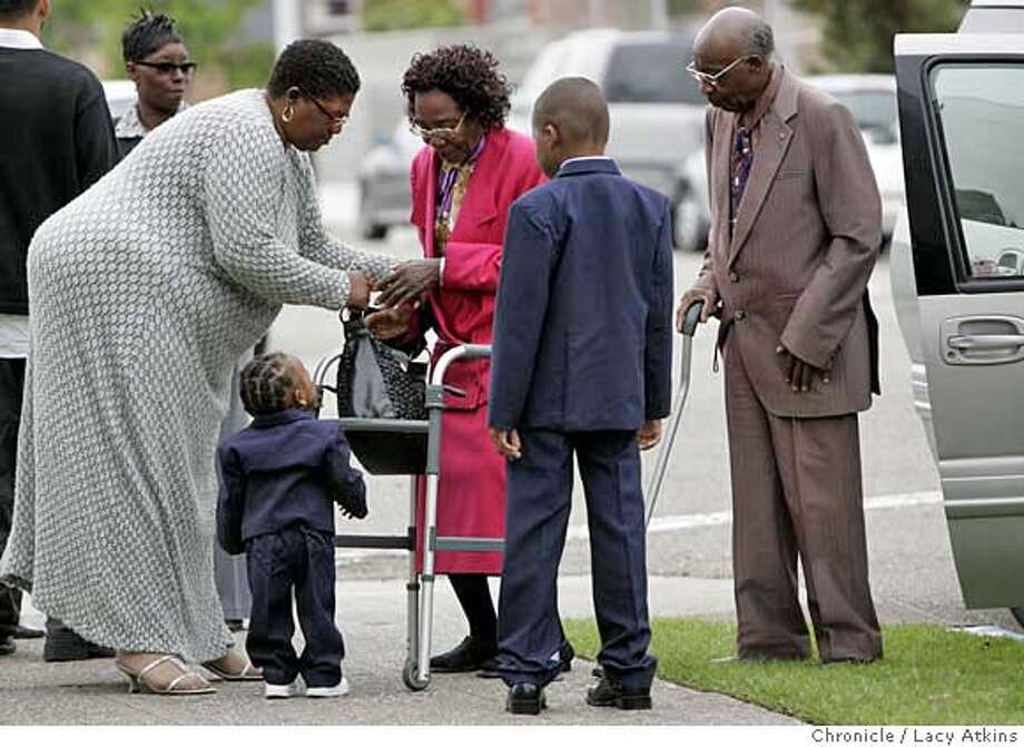 Dana Burford, Carmeron Moses, 18months and Charles Moses Jr. greet great grandmother and grandfather Alma and James Moses as they arrive at the funeral for Raijon Daniels at the Berkeley Mt. Zion Baptist Church, November 16, in Berkeley, Ca. He was 8 years old he died after allegedly beaten and tortured by his mother Teresa Moses, October 27, 2006. (Lacy Atkins/The Chronicle) MANDATORY CREDITFOR PHOTGRAPHER AND SAN FRANCISCO CHRONICLE/ -MAGS OUT Photo: Lacy Atkins