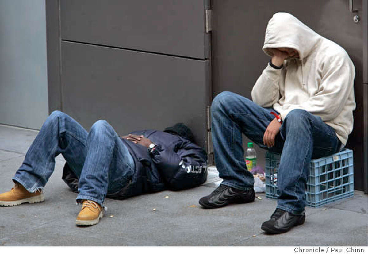 Two guys take a nap while waiting in line to buy a Sony Playstation 3 video game console at Metreon in San Francisco, Calif. on Thursday, Nov. 16, 2006. About 500 units were to be made available for the diehards - some who arrived at 8 a.m. Wednesday. PAUL CHINN/The Chronicle