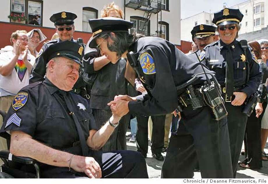 pride23_0040_df.jpg  Police chief Heather Fong congratulates Sergeant Elliott Blackstone for his work as a liason between the LGBT community and the San Francisco Police Department. The ceremony was held today to honor his work with the LGBT community and was also a commemoration of the Gene Compton cafeteria riot held on this corner of Taylor and Turk in 1966. Event San Francisco on 6/22/06.  Chronicle Photo by Deanne Fitzmaurice Ran on: 06-23-2006  Elliott Blackstone is congratulated by S.F. Police Chief Heather Fong at a ceremony honoring him.  Ran on: 06-23-2006  San Francisco Police Chief Heather Fong congratulates retired Sgt. Elliott Blackstone for his work with the transgender community.  Ran on: 06-23-2006 Ran on: 06-23-2006  S.F. Police Chief Heather Fong congratulates retired Sgt. Elliot Blackstone for his work with the gay, lesbian and transgender community.  Ran on: 06-23-2006  Elliot Blackstone is congratulated by S.F. Police Chief Heather Fong at a ceremony honoring him. Mandatory credit for photographer and San Francisco Chronicle. /Magazines out. Photo: Deanne Fitzmaurice