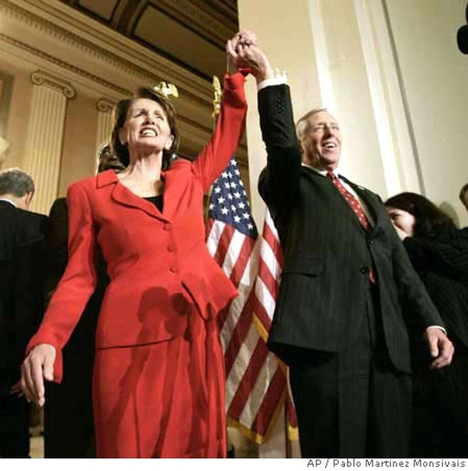 Incoming House Speaker Nancy Pelosi of Calif, left, and incoming House Majority Leader Steny Hoyer of Md., raise their arms during a news conference on Capitol Hill in Washington, Thursday, Nov. 16, 2006 to announce the new Democratic House leadership . (AP Photo/Pablo Martinez Monsivais) Photo: PABLO MARTINEZ MONSIVAIS