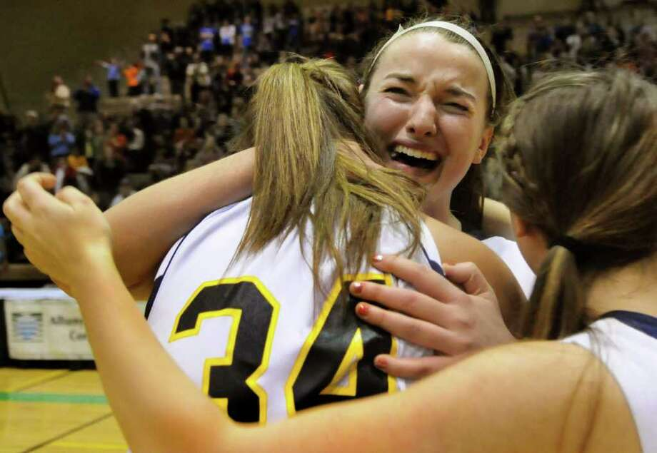 Averill Park's Brooke O'Shea, center, cries for joy as she hugs teammate Bridget Carney (34) when they win their Class A state semifinal basketball game over Pearl River on Friday, March 16, 2012, at Hudson Valley Community College in Troy, N.Y. (Cindy Schultz / Times Union) Photo: Cindy Schultz / 00016821A