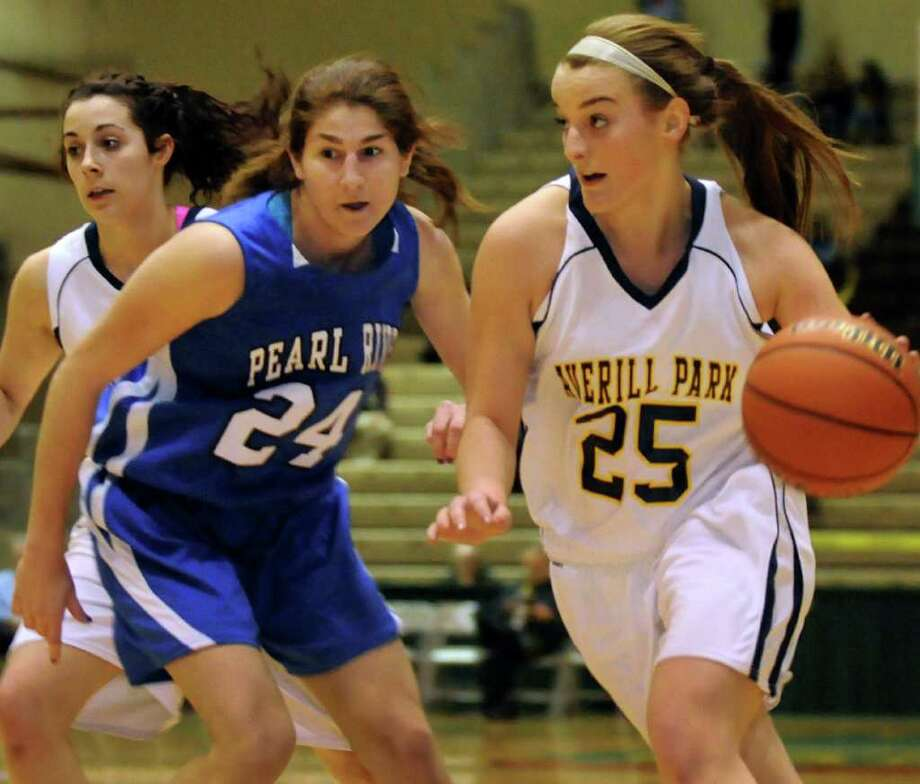 Averill Park's Brooke O'Shea (25), right, charges up court as Pearl River's Christa Scognamiglio (24) defends during their Class A state semifinal basketball game on Friday, March 16, 2012, at Hudson Valley Community College in Troy, N.Y. At left is Averill Park's Elaina Ryan. (Cindy Schultz / Times Union) Photo: Cindy Schultz / 00016821A