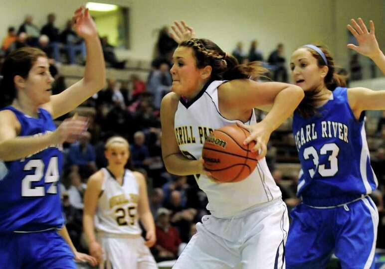 Averill Park's Bridget Carney (34), center, goes for the hoop as Pearl River's Christa Scognamiglio