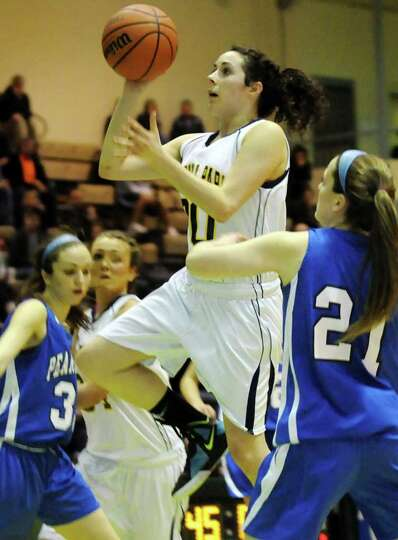 Averill Park's Elaina Ryan (30), center, goes for the hoop as Pearl River's Kerry Sullivan (21), rig