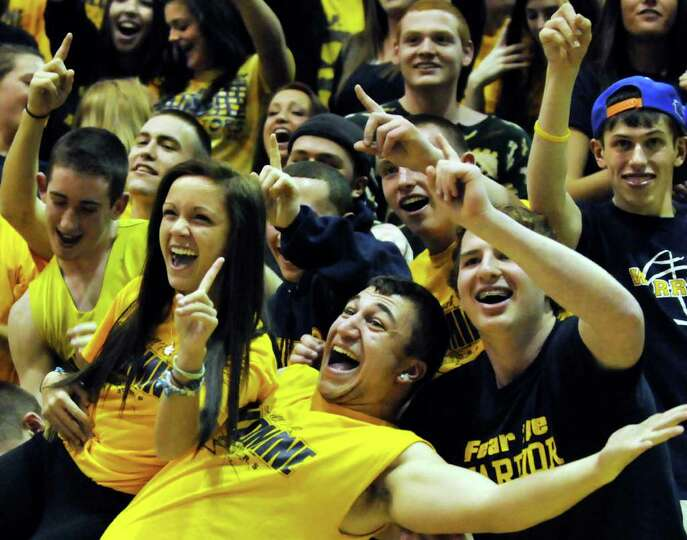 Averill Park's student section plays to the cameras during their Class A girls' state semifinal bask