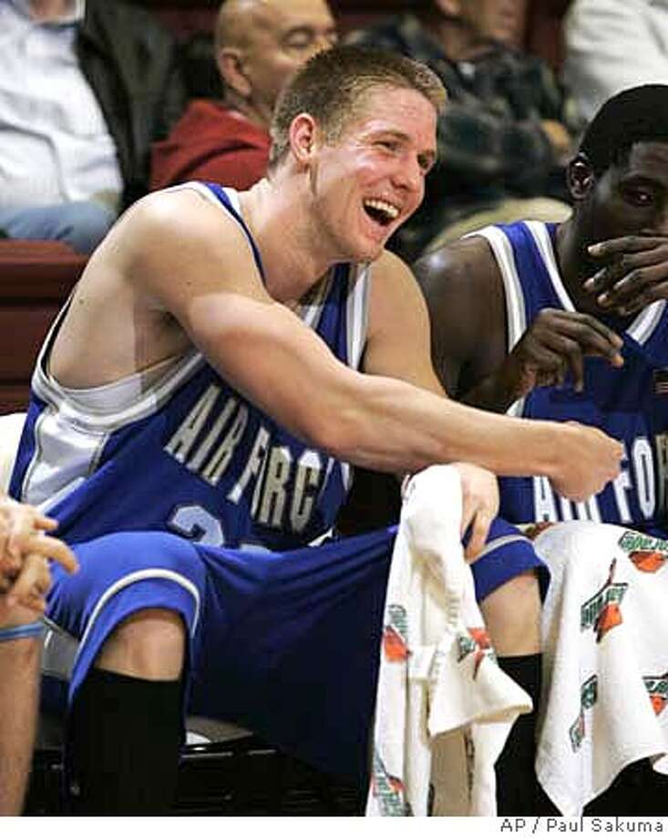 Air Force forward Jacob Burtschi smiles in the final minutes of their 79-45 win over Stanford in the CBE basketball Classic, Wednesday, Nov. 15, 2006 in Stanford, Calif. Burtschi was the game's high scorer with 24 points. (AP Photo/Paul Sakuma) Photo: PAUL SAKUMA