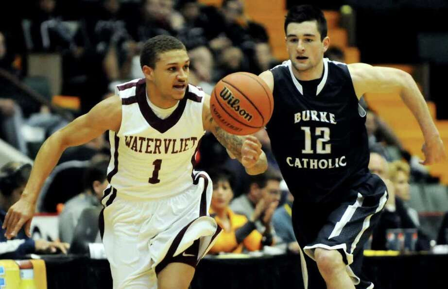 Watervliet's Jordan Gleason (11), left, steals the ball from Burke Catholic's Zach Rufer (12) during