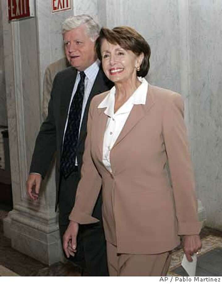 Democratic House Leader Nancy Pelosi of Calif., right, and Rep. John Larson, D-Conn. arrive at the Library of Congress in Washington, Wednesday, Nov. 15, 2006 to attend the orientation meeting for new Democratic elected members of Congress. (AP Photo/Pablo Martinez Monsivais) Photo: PABLO MARTINEZ MONSIVAIS