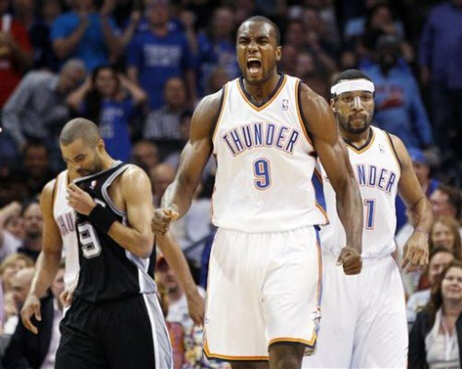 Oklahoma City Thunder forward Serge Ibaka (9), of Republic of Congo, reacts after being fouled in front of San Antonio Spurs guard Tony Parker (9) and Thunder forward Lazar Hayward, right, during the second quarter of an NBA basketball game in Oklahoma City, Friday, March 16, 2012. (AP Photo/Sue Ogrocki) (AP)