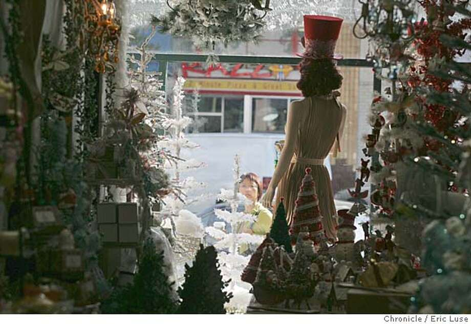 streetdate16_203_el.JPG  Looking out through a Christmas window display at Juniper Tree .  96 hour's street date of Lakeshore AvenuePhotographer:  Eric Luse / The Chronicle names cq with source MANDATORY CREDIT FOR PHOTOG AND SF CHRONICLE/ -MAGS OUT Photo: Eric Luse