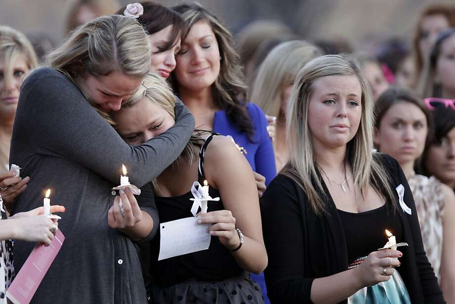 Katy Nozar, far left, embraces a fellow Alpha Xi Delta sister, Friday, March 16, 2012, during a candlelight vigil on the campus of Bowling Green State University in Bowling Green, Ohio. A memorial service and candlelight vigil was held for the three Bowling Green State University students killed March 2 when their car was hit by a wrong-way driver on Interstate 75 just north of Bowling Green. (AP Photo/Sentinel-Tribune, J.D. Pooley) MANDATORY CREDIT, TOLEDO BLADE OUT Photo: J.D. Pooley, Associated Press