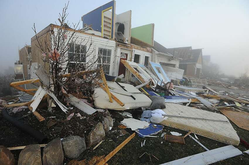 A house is destroyed by tornado damage in Dexter, Mich. Friday, March 16, 2012. Initial estimates indicate the tornado that hit Dexter, northwest of Ann Arbor, Thursday evening was packing winds of around 135 mph, National Weather Service meteorologist Steven Freitag said Friday. (AP Photo/Detroit News, Daniel Mears) DETROIT FREE PRESS OUT; HUFFINGTON POST OUT MAGS OUT MANDATORY CREDIT