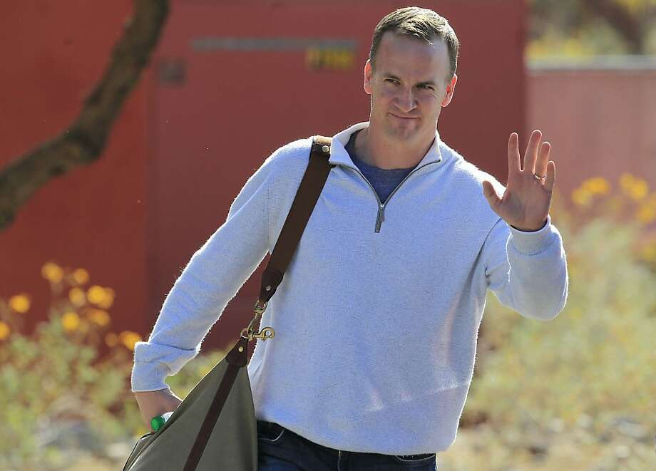 NFL quarterback Peyton Manning leaves the Arizona Cardinals training facility after a five hour meeting with coaches and front office staff Sunday, March 11, 2012, in Tempe, Ariz.(AP Photo/Ross D. Franklin) Photo: Ross D. Franklin, Associated Press