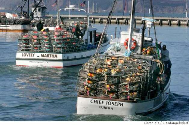 Crab boats head out to sea after agreeing on a price for their crab. Photo taken mid-day on Nov. 14, 2006 from pier 45.  Liz Mangelsdorf / The Chronicle Photo: Liz Mangelsdorf