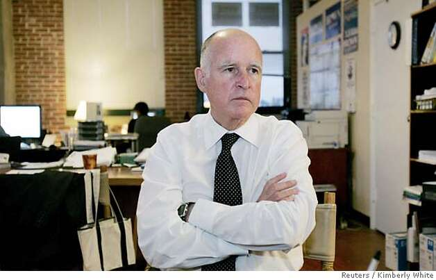 "Oakland Mayor Jerry Brown sits in his campaign office in Oakland, California October 12, 2006. Brown, nicknamed California's ""Governor Moonbeam"" in the 1970s for his unconventional ideas, at age 68 seeks to cap an unusual political career by becoming the state attorney general. Picture taken October 12, 2006. REUTERS/Kimberly White (UNITED STATES)  Ran on: 10-27-2006  Mayor Jerry Brown, above, refused to reprimand Jacques Barzaghi, says an ex-employee.  Ran on: 10-27-2006 Ran on: 10-27-2006 Ran on: 10-27-2006 Ran on: 11-14-2006  Jerry Brown  Ran on: 11-14-2006  Jerry Brown Photo: KIMBERLY WHITE"