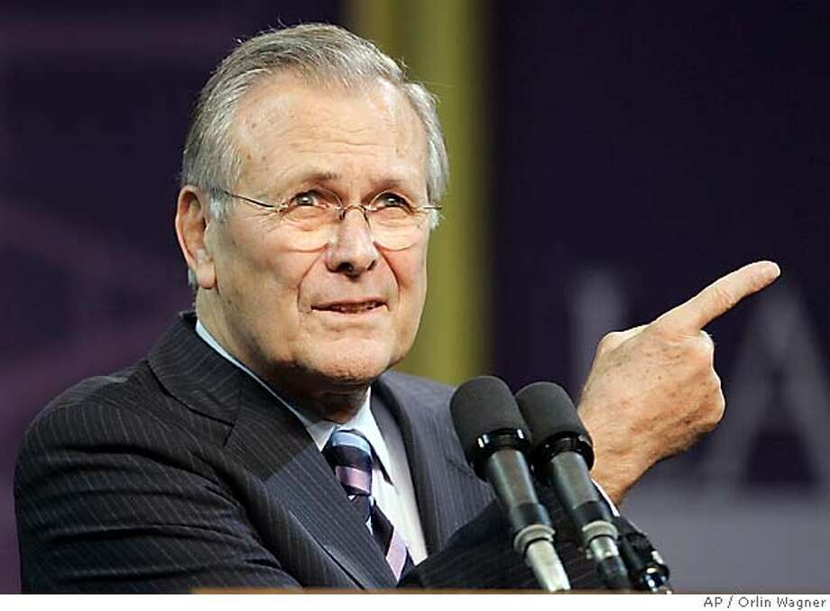 Defense Secretary Donald Rumsfeld asks for another question following his Landon Lecture at Kansas State University in Manhattan, Kan., Thursday, Nov. 9, 2006. (AP Photo/Orlin Wagner) Photo: ORLIN WAGNER