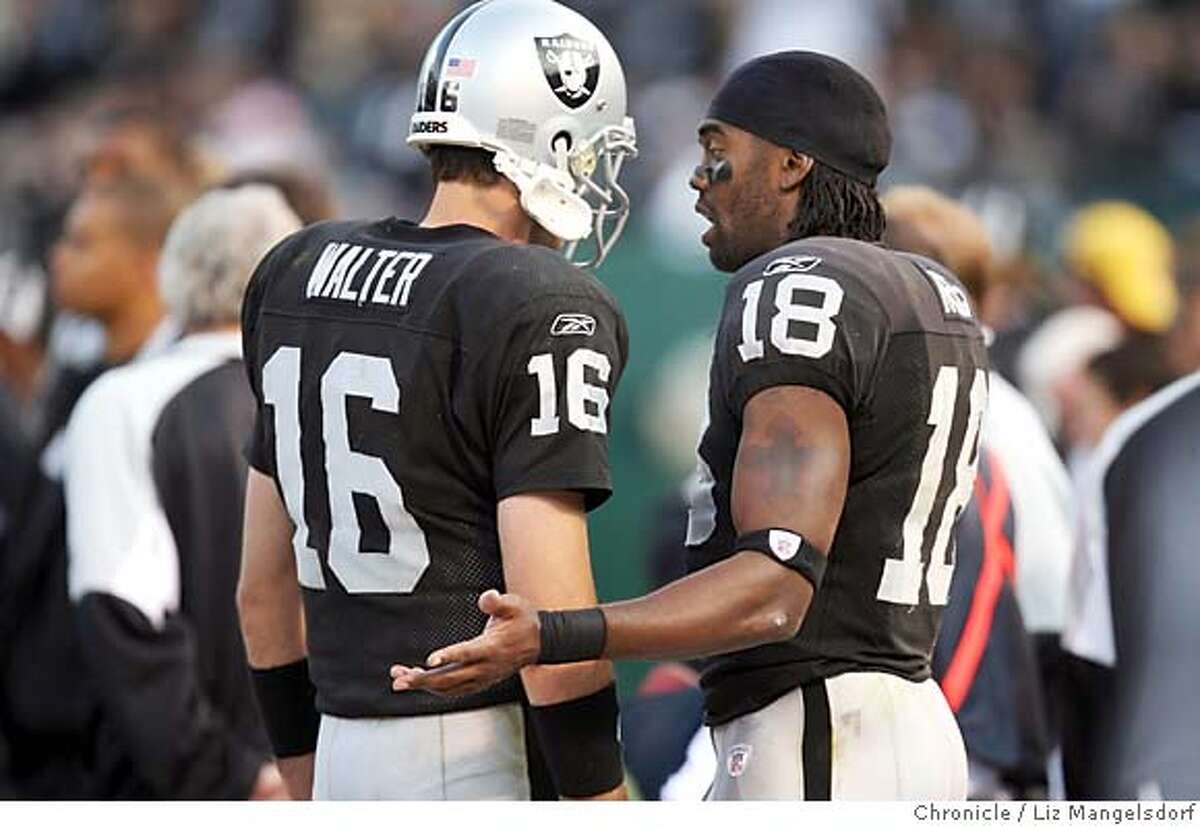 Oakland Raiders wide receiver Randy Moss (18) talks to Oakland Raiders quarterback Andrew Walter (16) on the sidelines in the 4th quarter. Oakland Raiders play the Denver Broncos at McAfee Coliseum on Nov. 12, 2006. Liz Mangelsdorf / The Chronicle MANDATORY CREDIT FOR PHOTOG AND SF CHRONICLE/ -MAGS OUT