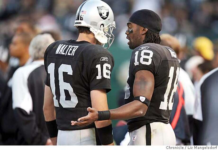 Oakland Raiders wide receiver Randy Moss (18) talks to Oakland Raiders quarterback Andrew Walter (16) on the sidelines in the 4th quarter. Oakland Raiders play the Denver Broncos at McAfee Coliseum on Nov. 12, 2006.  Liz Mangelsdorf / The Chronicle MANDATORY CREDIT FOR PHOTOG AND SF CHRONICLE/ -MAGS OUT Photo: Liz Mangelsdorf