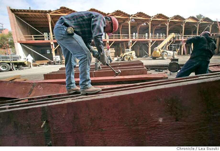 espritwood_056_ls.JPG  Arnold Melgar removes nails from some of the old growth lumber.  The old Esprit Bldg. is being demolished and it's massive interior beams -- from old-growth fir that no longer exist in such giant dimensions--are being deconstructed on Wednesday, November 1, 2006. Photo by Lea Suzuki/The San Francisco Chronicle  Photo taken on 11/1/06, in San Francisco, CA. **(themselves) cq. MANDATORY CREDIT FOR PHOTOG AND SAN FRANCISCO CHRONICLE/ -MAGS OUT Photo: Lea Suzuki