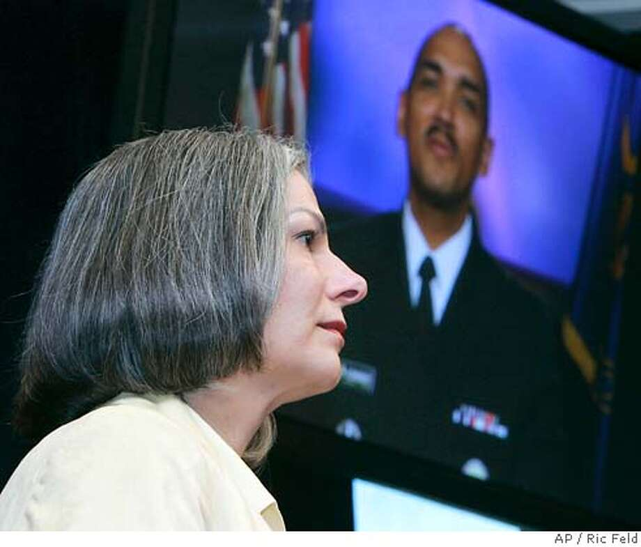 Dr. Julie Gerberding, director of The Centers for Disease Control and Prevention, left, listens as Dr. John Agwunobi, assistant secretary for Health, Department of Health and Human Services, speaks via video during a news conference about the influenza season and flu shots at the CDC in Atlanta, Ga., Monday, Nov. 13, 2006. (AP Photo/Ric Feld) Photo: RIC FELD