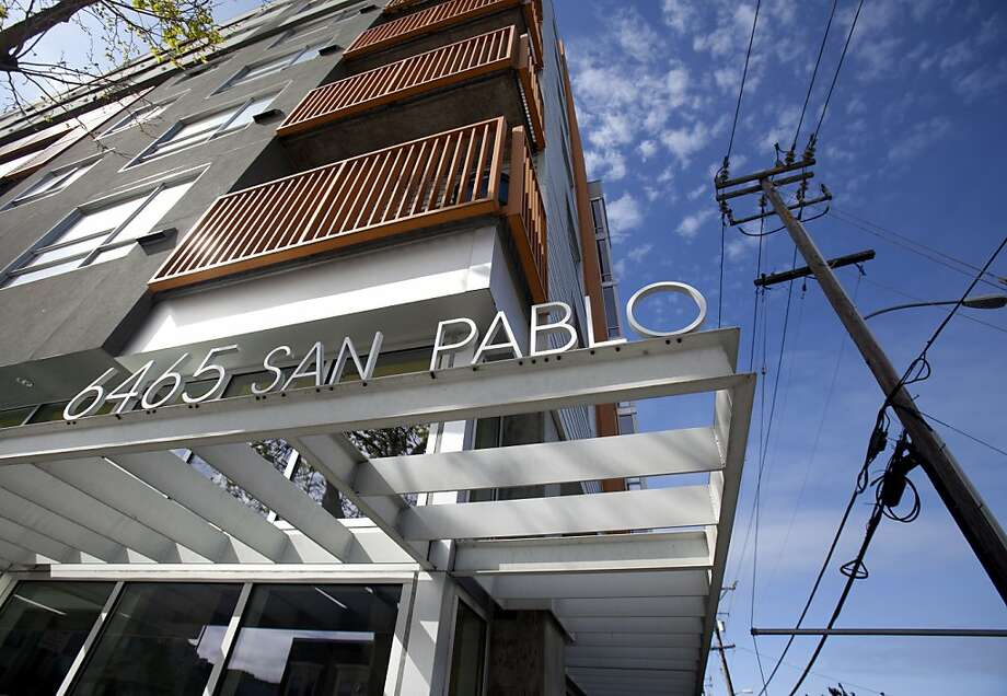 A new condominium building sits on San Pablo Avenue in Oakland, a corridor that is targeted for more development in the plan. Photo: Kevin Johnson, The Chronicle