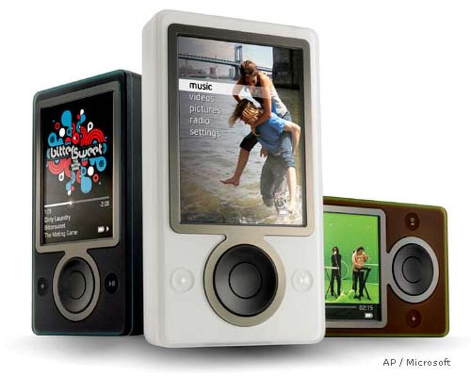 "In this photo provided by Microsoft on Thursday, Sept. 14, 2006, the new ""Zune"" portable media player is shown in black, white, and brown. The device represents Microsoft Corp.'s effort to compete against Apple's iPod will include wireless technology to let people share their favorite songs, playlists or pictures with other Zune users. Microsoft is headquartered in Redmond, Wash. (AP Photo/Courtesy Microsoft, Douglas Evans) Photo: DOUGLAS EVANS"