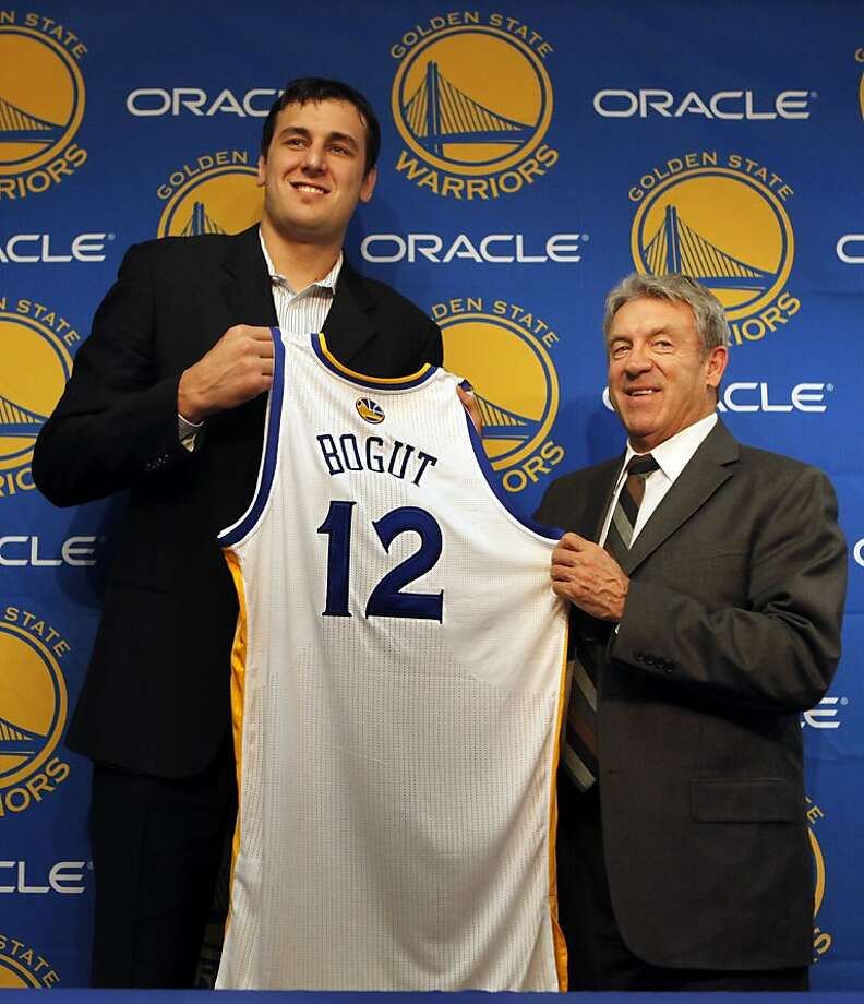 Golden State Warriors new center Andrew Bogut poses with his new jersey during a press conference with Warriors general manager Larry Riley Friday, March 16, 2012, in Oakland, Calif. Bogut was acquired from the Milwaukee Bucks earlier this week. Photo: Lance Iversen, The Chronicle