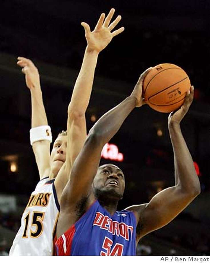 Detroit Pistons' Jason Maxiell (54) goes up for a shot as Golden State Warriors' Andris Biedrins, of Latvia, defends in the first quarter of an NBA basketball game Saturday, Nov. 11, 2006, in Oakland, Calif. (AP Photo/Ben Margot) Photo: BEN MARGOT
