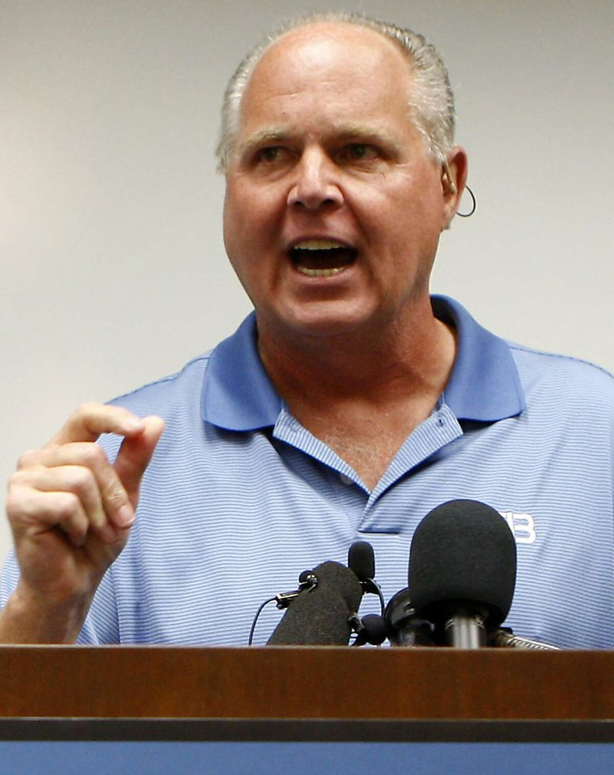 """FILE - In this Jan. 1, 2010 file photo, conservative talk show host Rush Limbaugh speaks during a news conference at The Queen's Medical Center looks on in Honolulu, after he was rushed to the hospital after experiencing chest pains during a vacation. Limbaugh, who for a quarter-century of radio dominance has gained clout and wealth with his salvos against Democrats, liberals, minorities, the poor and other disenfranchised groups. On his radio show, Limbaugh called Georgetown University student Sandra Fluke a """"slut"""" who wanted the government to subsidize her sex life. (AP Photo/Chris Carlson, file )"""