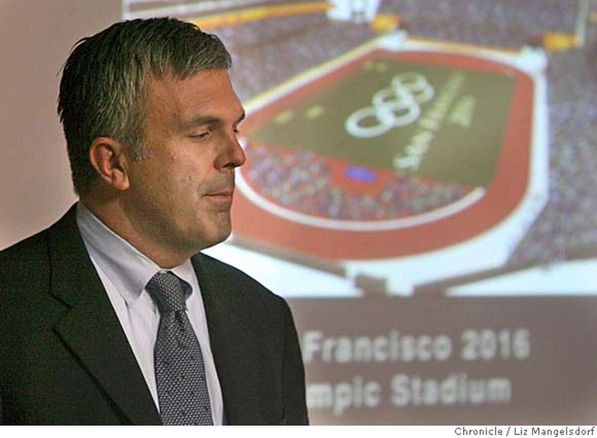 Scott Givens, Managing Director and CEO of the San Francisco 2016 Bid Committee, with a drawing of their proposed olympic stadium in the background, announced today that the committee is withdrawing its bid to host the 2016 Olympics in San Francisco. This announcement was made in the offices of Accenture in downtown San Francisco San Francisco 2016 on Nov. 13, 2006. Liz Mangelsdorf / The Chronicle