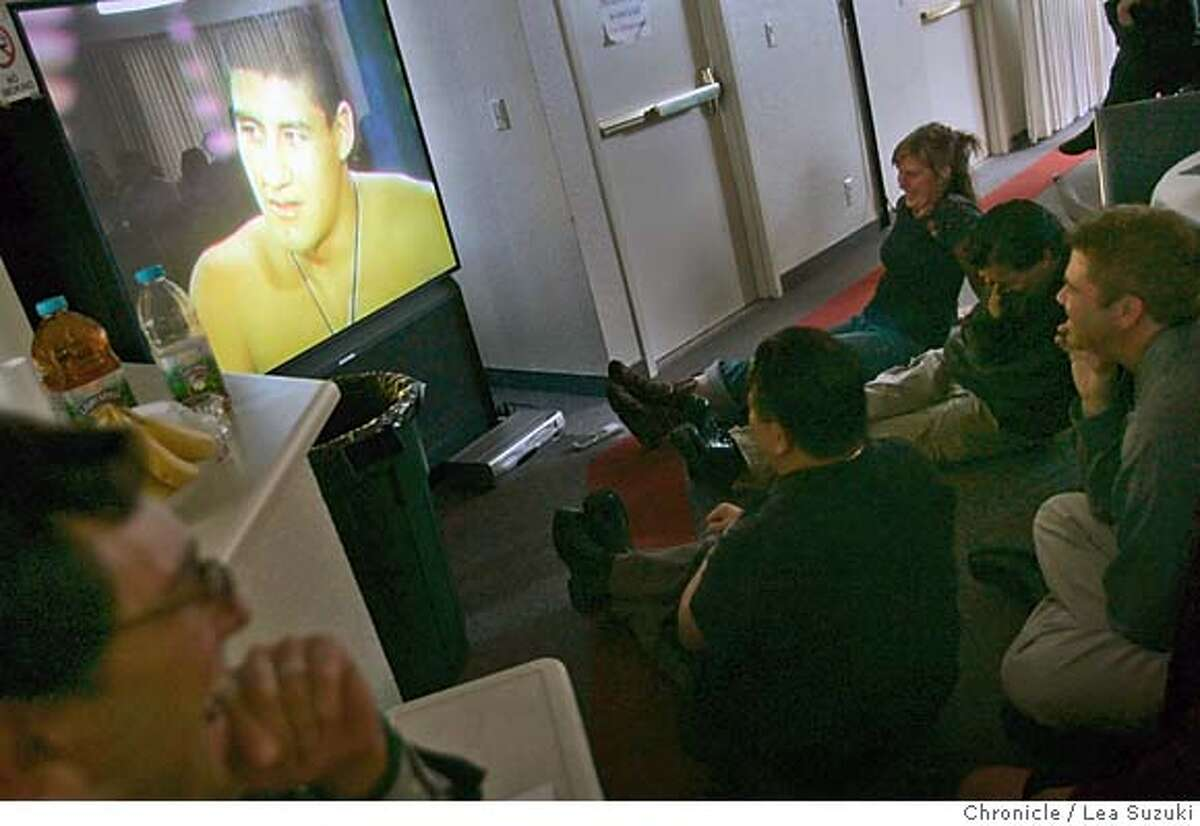martinez13_075_ls.JPG Attendees to the memorial watch a 20 minute video of of Martinez (on TV screen upper left) made by Martinez's girlfriend, Micaela O'Herliha of Milwaukee, Wisconsin during the memorial. Memorial for Luis Andrew Martinez, former UC Berkeley student known as The Naked Guy on Sunday November 12, 2006. Esther Krenn (Mother of Martinez) and Bryan Schwartz, of Oakland, organized the memorial at the Rancho RInconada Recreation Center in Cupertino. Martinez committed suicide in jail about six months ago, and his family and friends are gathering to remember him. Photo by Lea Suzuki/The San Francisco Chronicle Photo taken on 11/12/06, in Cupertino, CA. **(themselves) cq. MANDATORY CREDIT FOR PHOTOG AND SAN FRANCISCO CHRONICLE/ -MAGS OUT
